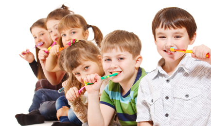A group of kids cleaning teeth, isolated